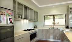 When renovating small kitchens, consider shallower cabinets so they don't jut out as far from the wall. Open shelving or those with see-through doors can also give the impression of more space. Consider increasing the space between the bench and the bottom of the cabinets to help your kitchen look more spacious.