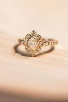 18 Outstanding Floral Engagement Rings ❤ Floral ring designs are very multifunctional and can easily be adapted towards an bride's preferences. See more: http://www.weddingforward.com/floral-engagement-rings/ #wedding #floral #engagement #rings