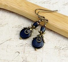 This is a beautiful Victorian inspired pair of black earrings. It combines Czech glass beads with antique gold accents to create a unique piece of jewelry. This earring can be worn dressed down for a casual day out, yet would be perfect worn dressed up for a formal event. Perfect for