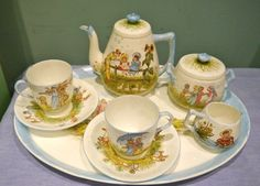 RARE Staffordshire Victorian Doll Child's Nursery Tea Set Hand Painted c.1873 | eBay    A RARE AND ABSOLUTELY BEAUTIFUL CHILD'S/DOLL'S  TEA SERVICE FOR TWO, EACH PIECE IS HAND-PAINTED WITH SCENES OF CHILDREN AT PLAY IN SUMMER MEADOWS. EACH SCENE IS DIFFERENT. IT BEARS THE VICTORIAN DATE CODE FOR 1873. THE BODY IS A VERY FINE BONE CHINA/PORCELAIN. BUN FEET ON THE SERVING TRAY.
