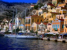 Waterfront and architecture Neoclassical architecture on Yialos waterfront. Symi island, Dodecanese, Greece
