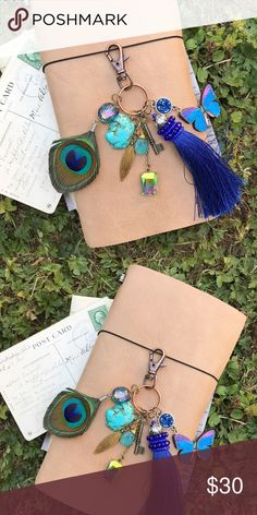 Junk keychain // bag charm•Vintage•Boho•Tassel This gorgeous charm can be used in many ways including: •Purse charms  •Planner charms •Lanyards •Keychains •Zipper pulls •Belt loops You will find several goodies in this mix.  Midnight blue faux druzy charm, purple & blue wooden butterfly, dark blue beaded tassel, tiny skeleton key charm, aqua blue pear shaped wire wrapped bead, gold feather charm, iridescent green & gold bead, real turquoise stone, and a real peacock feather. Handmade by me…
