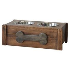 Hand-finished pinewood dog feeder with a personalized dog bone.  Product: Dog feederConstruction Material: PinewoodColor: WalnutFeatures:  Stained and hand-rubbed Includes chalkboard dog bone for personalizationBowls included Dimensions: 8 H x 23 W x 14 D