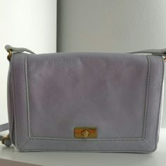 "Lilac J. Crew  purse Pre-owned. Can be use as a crossbody or shoulder bag. The adjustable strap extends  until 25"". Has a mark on the handle for adjusting the strap. Other than that good condition. J. Crew Bags Shoulder Bags"