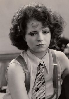 Clara Bow, 1929. sleeveless business shirt, necktie and suspenders.