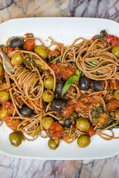 Spaghetti alla puttanesca This fantastic puttanesca recipe from Nina Parker is a bold and beautiful dish, packed with flavour from olives, tomatoes and anchovies. Italian Chef, Italian Pasta, Italian Dishes, Italian Recipes, Croatian Recipes, Italian Foods, Spaghetti Alla Puttanesca Recipe, Pasta Puttanesca, Vegetarian Recipes