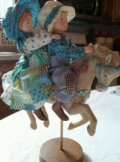 "Oh my, this is a ""like new"" resin Holly Hobbie & Robbie Riding Carousel Horse figurine. Holly and Robbie are wearing their original clothing with vibrant coloring. The figure stands about 10"" tall. The horse stands on a wooden base /attached to to a wooden dowel. Holly and Robbie are very well detailed, fantastic face color, fingers intact. The bottom of their shoes are marked TCFC (Those Characters from Cleveland) and Holly Hobbie. 