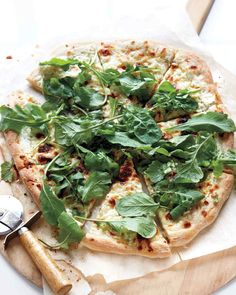 This pizza stars 3 cheeses melted on a crisp crust. Top with peppery arugula for a better-than-delivery dinner.