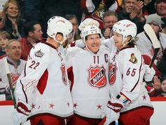 Captain Daniel Alfredsson, center, celebrates with Team Alfredsson teammates Daniel Sedin, left, and Erik Karlsson after scoring a second-period goal.