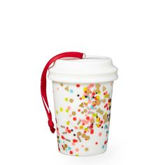 A collectible ceramic cup ornament sprinkled with confetti, part of the Starbucks Dot Collection.