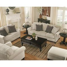 Signature Design by Ashley Milari - Linen Transitional Sofa with Rolled Arms with Nail Head Trim