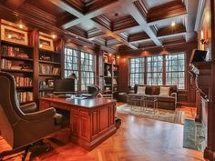 With wood-paneled walls, built-in bookcases, a fireplace and a coffered ceiling, the home's luxurious home office spares no expense. The use of rich, dark woods gives the space a sophisticated warmth. lIKE SCALE OF ROOM Home Library Design, Office Interior Design, Office Interiors, House Design, Office Designs, Corporate Interiors, Home Office Furniture, Home Office Decor, Home Decor