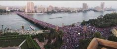Protesters occupy a bridge leading into Tahrir Square