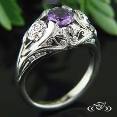 A round purple #sapphire blooms next to two carved roses on the side of the band. #Ido love #filigree and #GreenLakeJewelry!