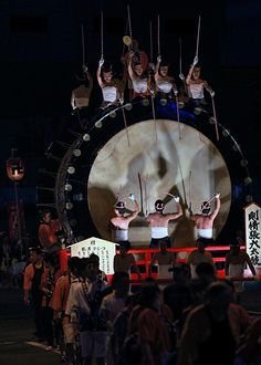 "This big drum follows ""Neputa"" (a big paper lantern). As you see, each 7 person play at front and back. 4 person sitting on the top are ladies full of vitality, shouuted very loudly. Light was very fantastic."