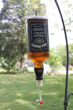 Homemade Hummingbird Feeder~You can use wine or liquor bottles and decorate as you like.