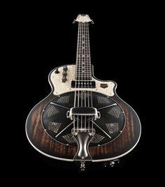 Une National Reso-Phonic Resolectric Revolver. Retrouvez des cours de guitare d'un nouveau genre sur MyMusicTeacher.fr