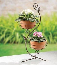 Online shopping for Planters - Pots, Planters & Container Accessories from a great selection at Patio, Lawn & Garden Store. House Plants Decor, Plant Decor, Iron Furniture, Garden Furniture, Outdoor Metal Plant Stands, Garden Shelves, Wrought Iron Decor, Decoration Plante, Branch Decor