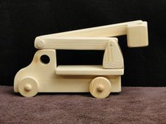 This is a fun truck for any child. The bucket raises, lowers and swivels around in a full circle. They can use this truck and bucket to fix and install what ever their imagination can come up with. Made of solid wood and finished with a non-toxic child safe Mineral Oil. This truck can help teach your child about balance and leverages. By using the bucket extended to far out to one side the truck will tip over. Learning how to adjust the bucket to balance the truck and reach out is the trick…