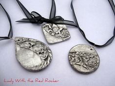 Salt dough (baked at 250 for 2 hrs), silver spray paint, antiqued with thinned black paint-- awesome!