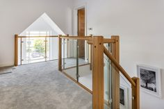 Galleried landing with timber / glass balustrade and feature window