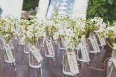 adorable flower vases turned escort cards! love, love, love. | via http://emmalinebride.com/decor/25-best-escort-card-ideas-weddings/