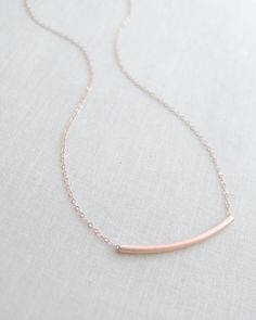 Curved Bar necklace by Olive Yew in rose gold. Transitions from day to evening perfectly!
