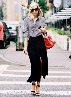 Gingham button up shirt tucked into a black high-slit skirt