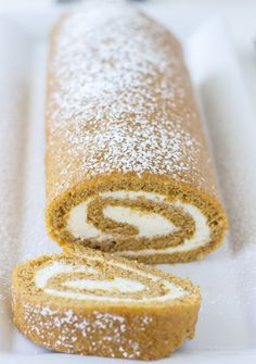 A classic pumpkin roll cake with a spiced ginger cream cheese frosting.