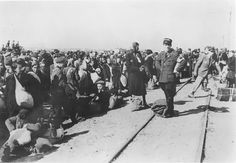 Lodz, Poland, Jews awaiting a deportation train under the supervision of Jewish policemen. They will be sent to death camp and almost all will be immediately gassed to death, and a few remaining selected for slave labor...a slow, agonizing death