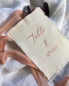 Rose gold calligraphy table numbers on handmade paper