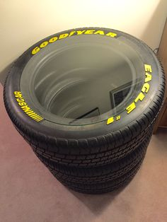 Made a super cool side table for my hubby with the discontinued NASCAR tires that use to be on his Monte Carlo. Luv that I was able to get the glass cut to fit inside the lettering so there's no over hang to bump into. #paris8_can_decor8 #NASCAR #tables #interior design #interior decorating #DIY