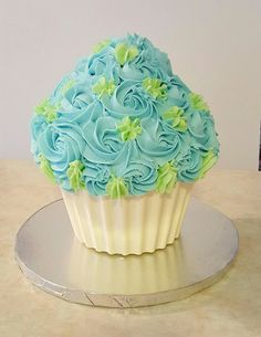 Giant cupcake - with white chocolate base, filled with chocolate cake, covered with buttercream icing.