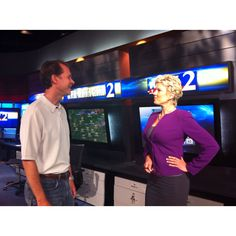 Meteorologist Karen Minton and Brad Nitz training on state-of-the art weather equipment