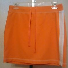 Ann Taylor loft short skirt. Euc. Orange color.w.white line in the side. Ann Taylor Skirts