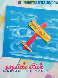 Popsicle Stick Airplane Kid Craft Idea - simply glue wooden craft sticks to a piece of cardstock in an airplane shape and then have children decorate it! Find TONS of kid craft ideas on Glued To My Crafts