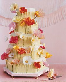 These crepe-paper flowers adorn a fondant-covered cake.