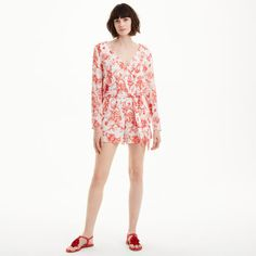 Rendered in a pretty crinkled fabric, our Makayla pairs a vibrant red French toile pattern with a breezy romper silhouette and thoughtful details like a removable tie belt and split sleeves with covered buttons. Viscose/nylon; lining: polyester  Straight fit  3' inseam, based on a size 6 Deep v-neck with interior snap button; elasticized waist; removable self-tie belt; split sleeves with fabric-covered button-and-loop closure Lined Dry c