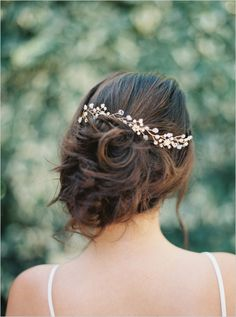 wedding updo with vine inspired hair pin