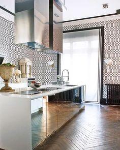 mirrored kitchen cabinets herringbone floors graphic wallpaper