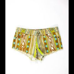 "NWT TIG MULTICOLORED BOHO AZTEC DENIM SHORTS SZ 4 NWT TIG MULTICOLORED IKAT DENIM 5 POCKET FRAYED TRIM SHORTS SZ 4  BELT LOOPS: YES  LEG TYPE: SHORTS  CLOSURE: ZIPPER BUTTON  PRINT: ABSTRACT IKAT STRIPED  POCKETS: 3 FRONT 2 BACK  LINING: UNLINED  SIZE: 4 COLOR: MULTICOLORED  FABRIC: 100% COTTON   EMBELLISHMENTS: FRAYED TRIM  MEASUREMENTS: WAIST: 30"" HIPS: 33"" INSEAM: 2.5""  NEW: WITH TAG Tig Shorts Jean Shorts"