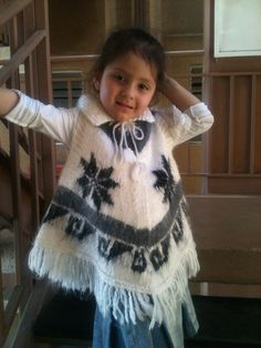 Girls' Wool Poncho Handknit in white and traditional Andean designs in black and light gray