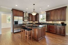 """""""Traditional Tuesday"""" Kitchen of the Day: Beautiful cherry cabinets, hardwood floors, black granite countertops, and an island with seating give this traditional kitchen a feeling of classic luxury."""