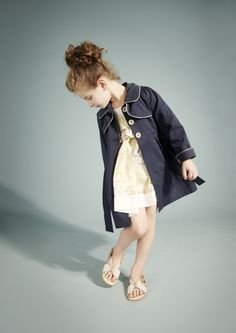 Hucklebones summer 2012 a piped children's tailored raincoat contrasts with the pale silk print underneath :via smudgetikka