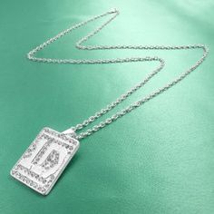 One Direction '1D' Crystal Dog Tag Necklace One Direction Official Jewelry. $21.99. Long silver plated chain. Crystal covered 1D tab logo necklace. OFFICIAL ONE DIRECTION MERCHANDISE