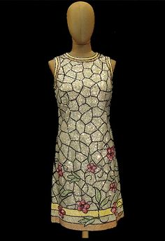 Vintage Valentino      Looks like a Tiffany (the stained glass co.) window!  Stained glass in fabric