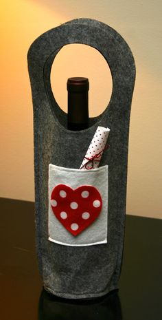 Jazz up a wine tote by sewing on a pocket and adding a love note. This felt tote was $.99! Find them at craft and fabric stores.