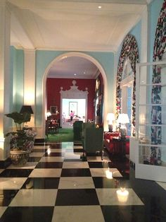 Marble checker floor with blue walls and emerald green furniture