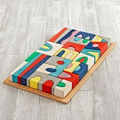 While your kid may not be a certified city planner, this block set will at least provide them with the proper training.  It's colorfully dyed in water-based inks then hand-sanded for a beautiful look.