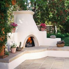 Use these outdoor fireplace ideas to give your deck, patio, or backyard living room a dramatic focal point. Browse pictures of fireplace designs for decorating ideas, inspiration, and tips on how to build an outdoor fireplace. Stucco Fireplace, Outside Fireplace, Outdoor Fireplace Designs, Diy Fireplace, Outdoor Fireplaces, White Fireplace, Adobe Fireplace, Electric Fireplaces, Outdoor Rooms